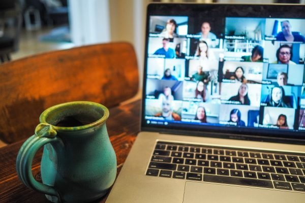 table with mug and laptop with zoom event